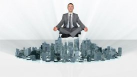 Businessman meditating and slowly rising with city growing around him - motion graphic
