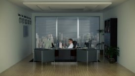 Businessman in Office with Skyline on the Background