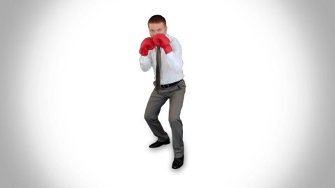Businessman Boxing, full length against white - stock footage
