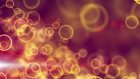 glowing yellow circle lights seamless loop background - stock footage
