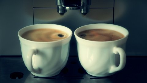 coffee mchine pouring espresso in two cups - stock footage