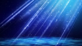 loopable background flying blue particles in light beams - motion graphic