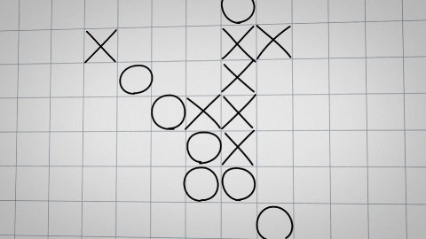 tick tack toe game on checked paper animation - stock footage