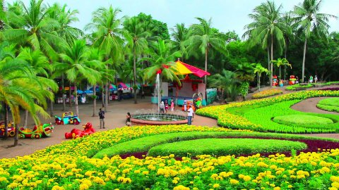 peoples walks in Nong Nooch tropical garden in Thailand - stock footage