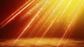 loopable background flying gold particles in light beams - motion graphic