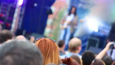 crowd of people watching concert outdoor - stock footage