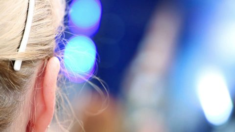 head of woman watching concert - stock footage