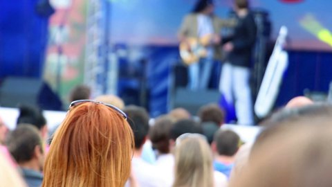 people watching outdoor concert - stock footage