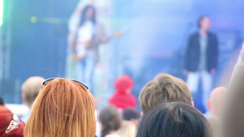 heads of people watching concert outdoor - stock footage