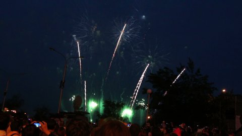 crowd of people watching fireworks - stock footage