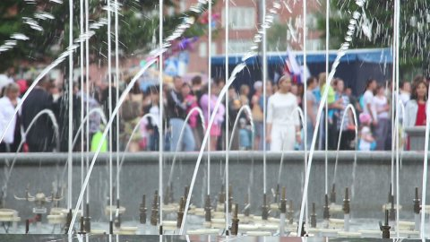 splashes of fountain water and crowd of people - stock footage