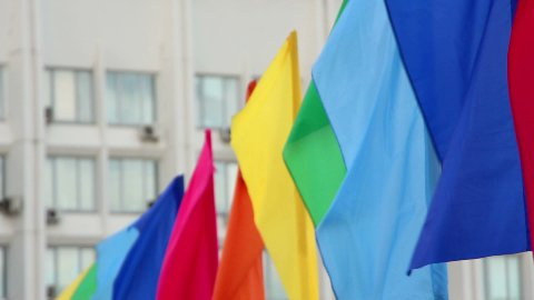 colorful flags against building - stock footage