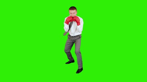 Young businessman boxing and hitting himself, Green Screen - stock footage