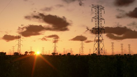 Electricity pillars at sunrise - stock footage