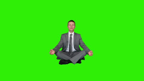 Young businessman meditating, Green Screen - stock footage