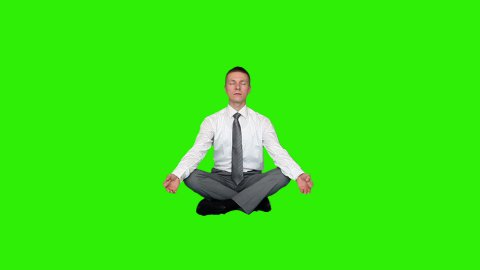 Young relaxed businessman meditating, Green Screen - stock footage