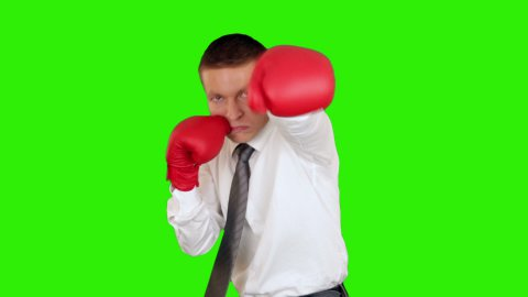 Young businessman boxing and hitting himself, close-up, Green Screen - stock footage