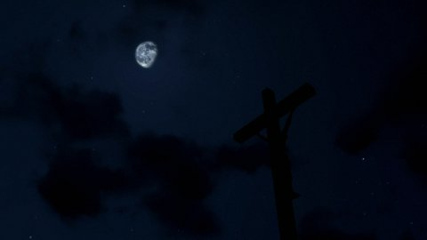 Jesus on Cross, timelapse clouds at night - stock footage