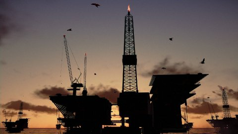 Oil rigs in ocean, timelapse sunrise night to day - stock footage