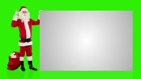 Santa Claus shaking bell presenting a white sheet, Green Screen - stock footage