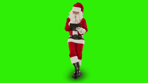 Santa Claus taking notes on a clipboard and sitting, Green Screen - stock footage