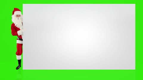 Santa Claus appears behind a wall with space for text, Green Screen - stock footage