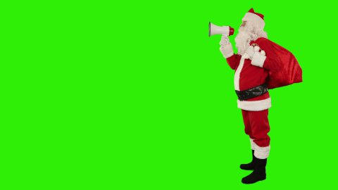 Santa Claus with a loudspeaker making an announcement, Green Screen - stock footage