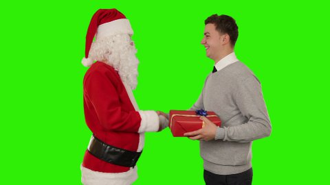 Young Businessman receiving a present from Santa Claus, Green Screen - stock footage