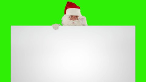 Santa Claus appears behind a white sheet with space for text, Green Screen - stock footage