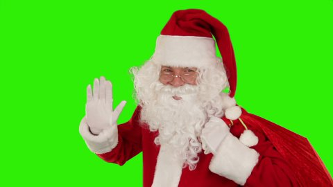 Santa Claus carrying his bag, is looking at camera and sends a kiss, Green Scree - stock footage