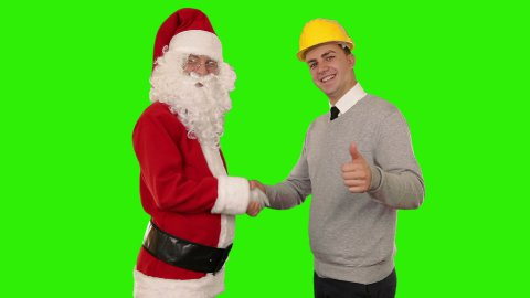 Santa Claus and Young Architect shaking hands, Green Screen - stock footage