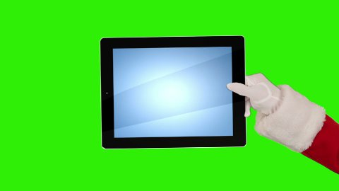 Santa Claus Presenting a Tablet then sending a Kiss and saying Bye Bye, Green Screen - stock footage