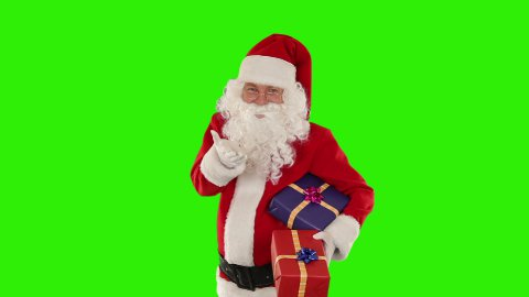Santa Claus holding presents, Green Screen - stock footage