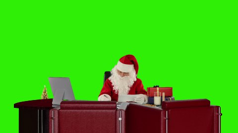 Santa Claus reading letters and sorting presents, Green Screen - stock footage