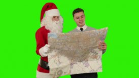 Santa Claus with a Young Businessman reading a map, Green Screen - motion graphic