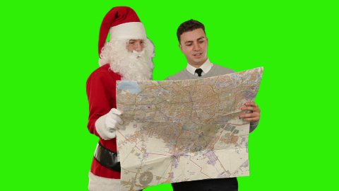 Santa Claus with a Young Businessman reading a map, Green Screen - stock footage