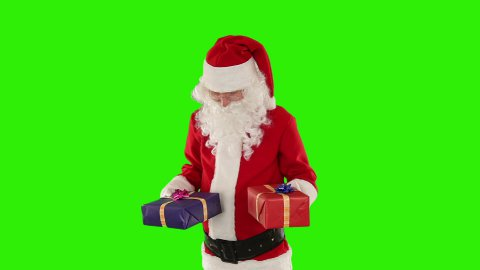 Santa Claus weighting presents, Green Screen - stock footage