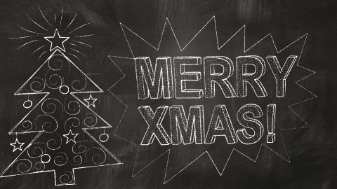 drawing merry christmas greetings on blackboard - stock footage