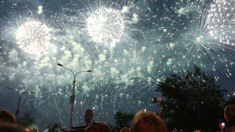 crowd of people watching fireworks in night city  - stock footage