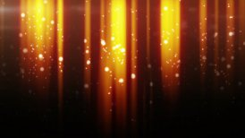 gold particles flying in light beams loop