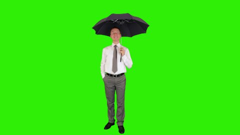 Young businessman opening umbrella, Green Screen - stock footage
