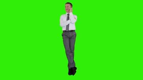 Young businessman on mobile and sitting, Green Screen - stock footage