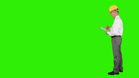 Young architect taking notes on a clipboard, walk in,Green Screen - stock footage