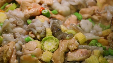 cooking seafood and vegetables close-up sequence - stock footage