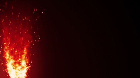 blazing fire flame and sparks loopable background - stock footage