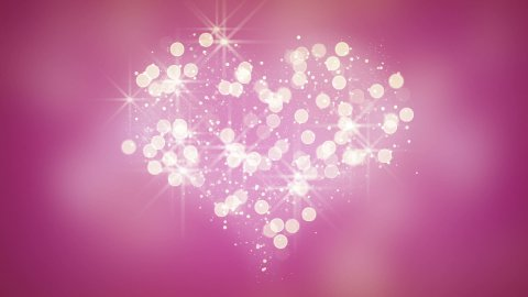 glares and particles heart shape loop background - stock footage