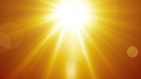 yellow sun rays and lens flare loopable background - motion graphic