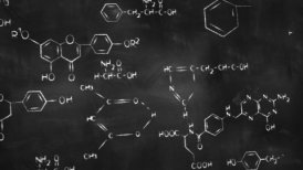 chemical formulas on chalkboard panning loop - motion graphic