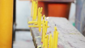 row of candles in buddhistic temple outdoor - motion graphic