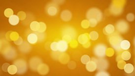 shiny orange defocused lights loopable background